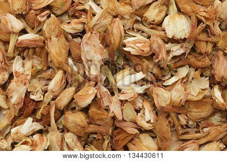 Organic dry Jasmine tea (Jasminum officinale) leaves. Macro close up background texture. Top view.