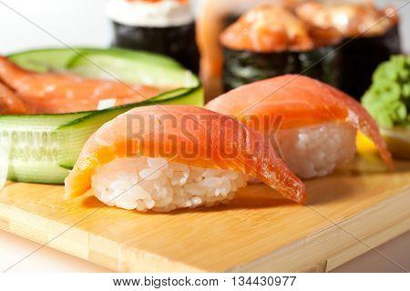Japanese Cuisine - Salmon Sushi Set. Nigiri and Sashimi with Gunkan Maki Sushi with Red Roe