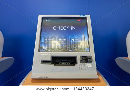 NEW YORK - MARCH 14, 2016: check-in kiosk in JFK airport. John F. Kennedy International Airport is a major international airport located in the Queens borough of New York City, United States.