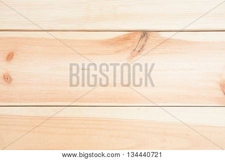 Light laconic natural wooden background with knots