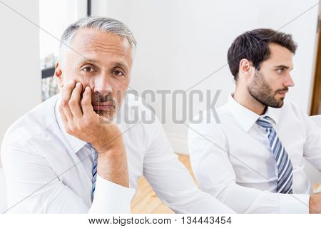 Portrait of bored businessman in a meeting