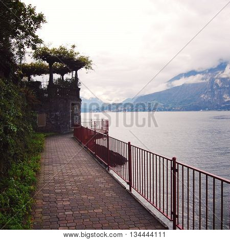 Small town of Varenna. Lake Como Italy. Autumn. Walking along the lake Como. Aged photo. City view. Varenna Lake Como Italy.