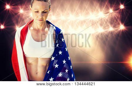 Portrait of american sportswoman unsmiling against flash light