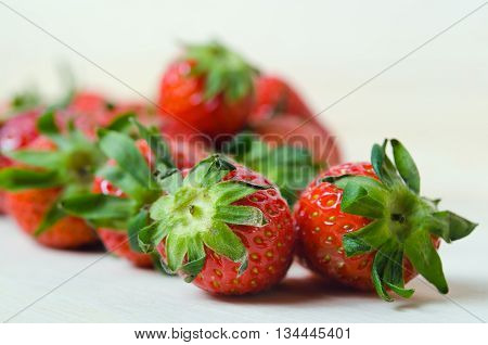 Strawberry Red ripe group of strawberry fruit on wooden board (Other names are Fragaria strawberry Fragaria ananassa)