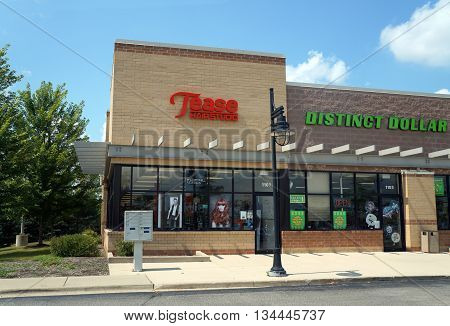 SHOREWOOD, ILLINOIS / UNITED STATES - AUGUST 16, 2015: One may have one's hair cut at Tease Hair Studio, in a Shorewood strip mall.