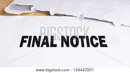 final notice. letter and opened envelope on desk