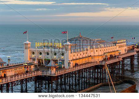 BRIGHTON, UK - CIRCA APRIL 2013: The Brighton Pier at sunset.
