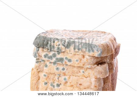 moldy toast bread isolated on white background
