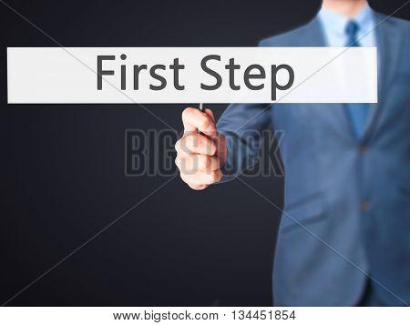 First Step - Businessman Hand Holding Sign