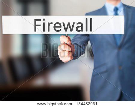 Firewall  - Businessman Hand Holding Sign