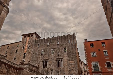 GIRONA SPAIN - JULY 17 2013: In the ancient quarter in Girona on July 17 2013. Well preserved since the Middle Ages the historic core of the city attracts a significant number of tourists