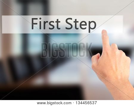 First Step - Hand Pressing A Button On Blurred Background Concept On Visual Screen.