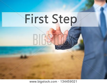 First Step - Businessman Hand Pressing Button On Touch Screen Interface.