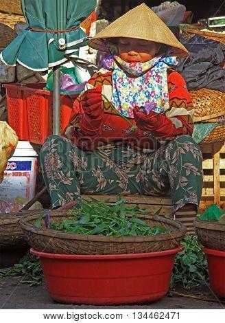 Woman Is Selling Greens On Street Market In Hue, Vietnam