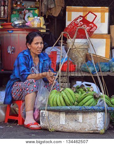 Woman Is Selling Bananas On Street Market In Hue, Vietnam