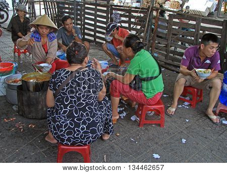 People Are Eating On Street Market In Hue, Vietnam