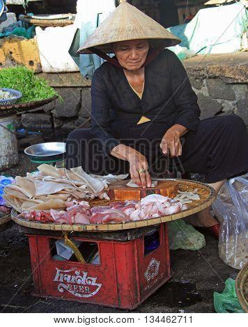 Woman Is Selling Meat On Street Market In Hue, Vietnam