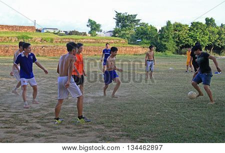 Guys Are Playing Football Outdoor In Hue, Vietnam