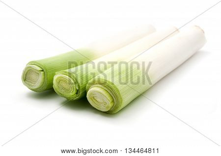 Close up of some Leek stems on a white background