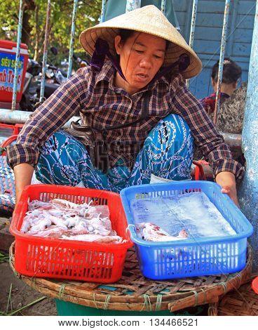 Woman Is Selling Seafood On Street Market In Hue, Vietnam