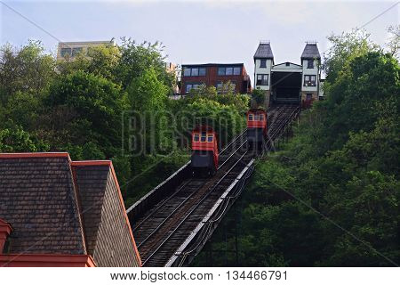 Duquesne Incline in Pittsburgh - recreational double cabin Incline small train (railroad) system moved from the weight of the cabins seen is railroad cabins upper station and roof of lower station