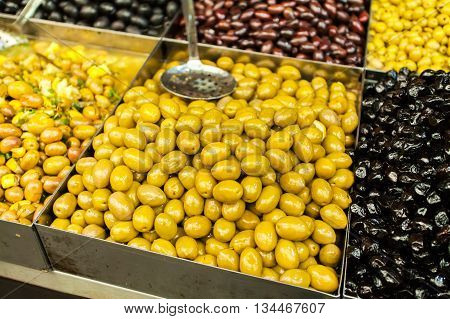 Pickled olives in the Mahane Yehuda Market in Jerusalem. Selling and buying.