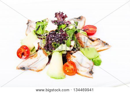 Fresh salad with avocado and smoked unagi. Served with tomatoes cherry and feta cheese. Macro. Photo can be used as a whole background.