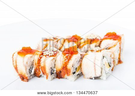 Traditional japanese sushi roll with smoked unagi and red tobiko caviar. Macro. Photo can be used as a whole background.