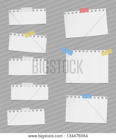 Pieces of cut out white notebook paper are stuck on gray striped background.