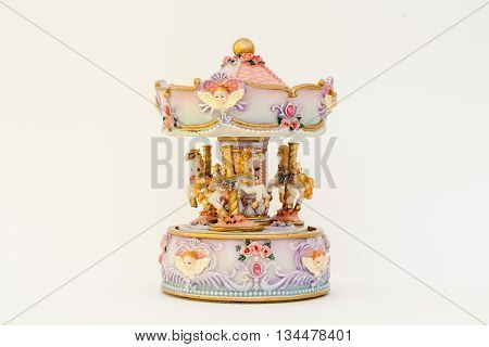 Beautiful toy carousel in the Baroque style. Horses Tutti Roses.