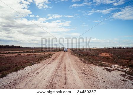 Landscape of a dirt road in outback Queensland, Australia.