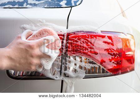 Handle Car Wash - Male Hand Washing Car Headlight