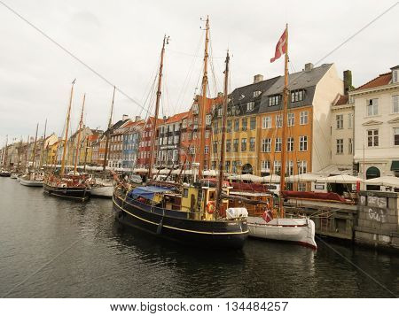 COPENHAGEN DENMARK - CIRCA JUNE 2016: Pictorial view of the old port Nyhavn (actually meaning New Port) popular touristic landmark of Copenhagen built in 17th-century
