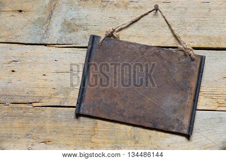 Rusty Metal Sign On Wooden Table