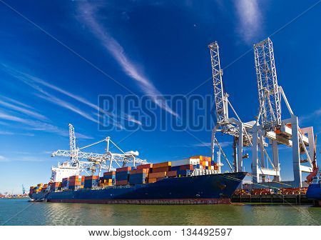 Large container vessel unloaded in Port of Rotterdam Netherlands