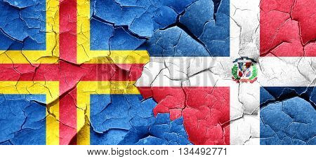 aland islands with Dominican Republic flag on a grunge cracked w