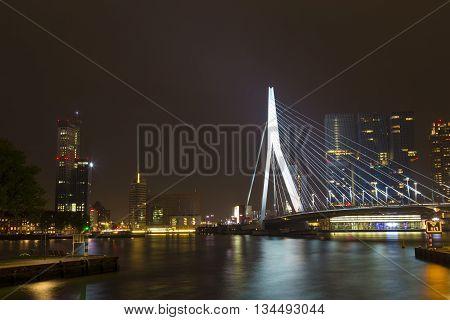 Rotterdam, Netherlands - 24 MAY 2015: Nightview of the Erasmus Bridge reflected in Nieuwe Maas river in Rotterdam Netherlands