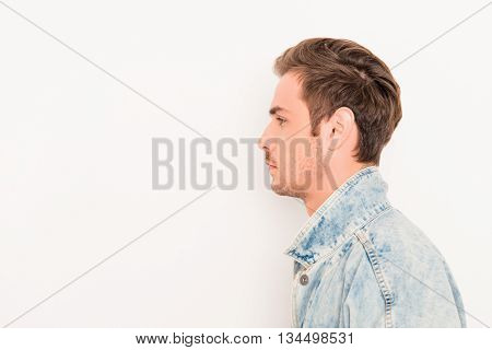 Side View Of Young Hansome Man Isolated On White Background