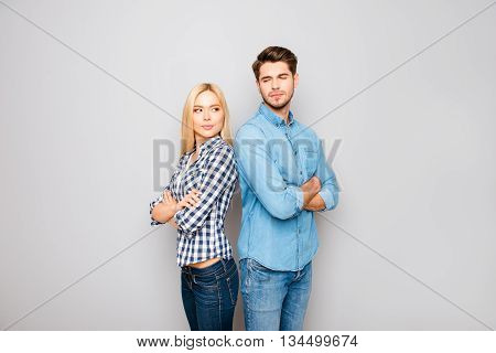 Young Angry Couple In Love Standing Back To Back