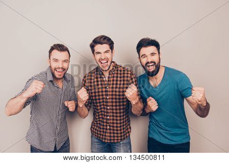 Yeah! Three  Handsome Screaming Men Showing Their Strong Hands