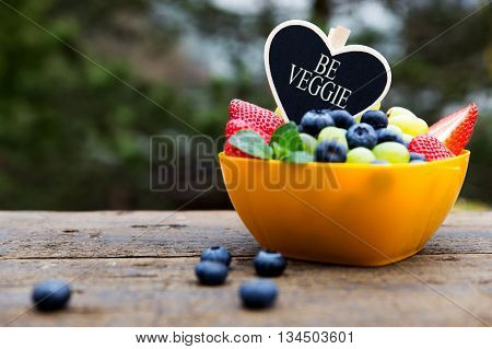 Strawberries, Grapes And Blueberries On Wooden Table, Heart, Be Veggie