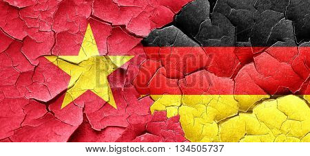 Vietnam flag with Germany flag on a grunge cracked wall