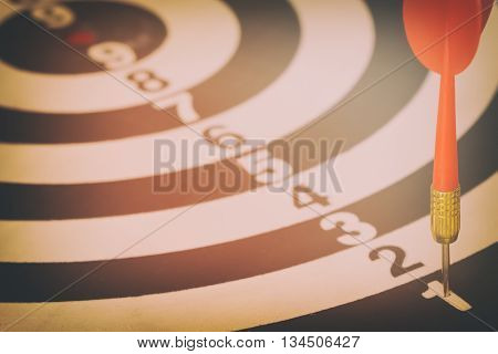target dart with target arrows and dartboard is the target and goalabstract background to target marketing or target arrow concept .