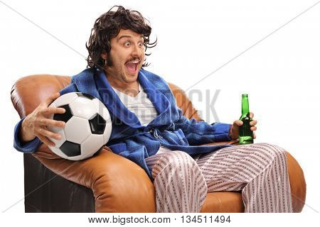 Ecstatic football fan watching a game on TV and drinking beer isolated on white background
