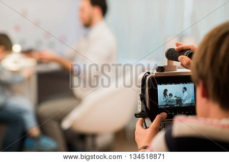 Professional video camera or camcorder recording stock footage medical theme