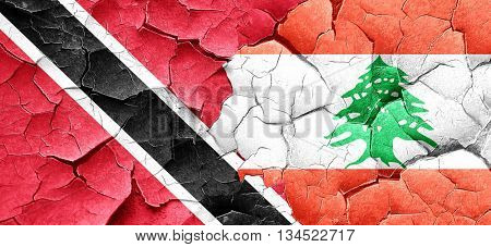 Trinidad and tobago flag with Lebanon flag on a grunge cracked w