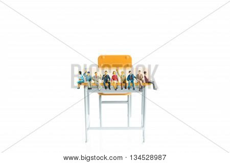 people are sitting on top of the desk