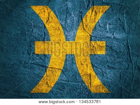Fish astrology sign. Yellow astrological symbol on concrete textured backdrop