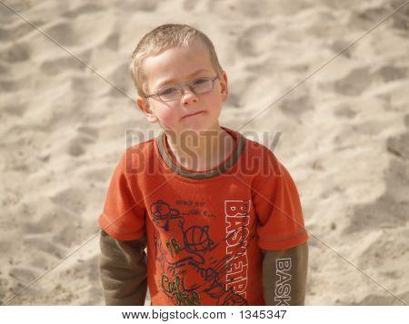 Small Boy On A Big Beach