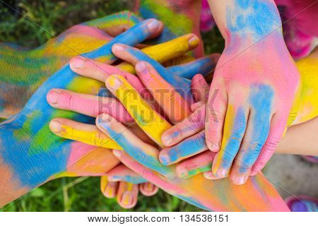 Hands painted in different colors. Concept of love, friendship, happiness in family.